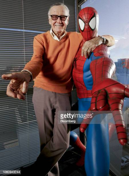 Stan Lee founder of Marvel Entertainment Inc poses for a photograph with a life size model of his superhero SpiderMan while in his office in Beverly...