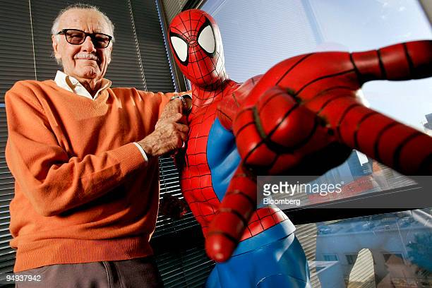 Stan Lee founder of Marvel Entertainment Inc poses next to a SpiderMan model in his office in Beverly Hills California US in this file photo taken on...