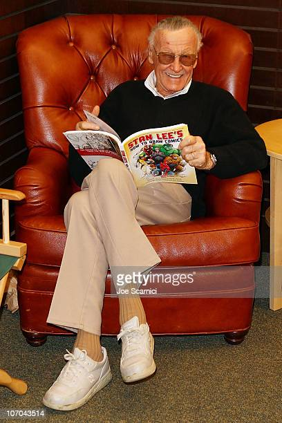 Stan Lee poses with his new book Stan Lee's How To Draw Comics during a book signing at Barnes Noble bookstore at The Grove on November 20 2010 in...