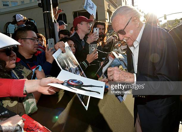Stan Lee signs autographs during The World Premiere of Marvel's Captain America Civil War at Dolby Theatre on April 12 2016 in Los Angeles California
