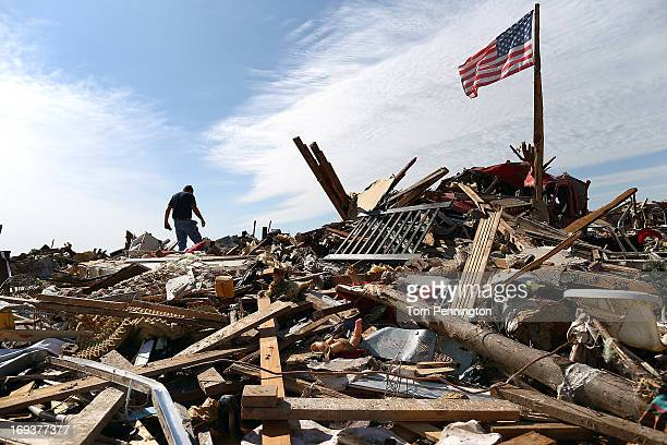 Stan Mallette searches through the rubble of his son's home on May 23 2013 in Moore Oklahoma The tornado of at least EF4 strength and two miles wide...