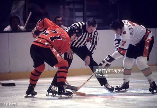 Stan Mikita of the Chicago Blackhawks and Team West and Phil Esposito of the Boston Bruins and Team East faceoff during the 26th NHL AllStar Game on...