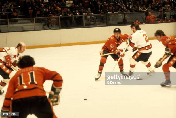 Stan Mikita of the Chicago Blackhawks and Team West goes for the puck as Brad Park of the New York Rangers and Team East checks him during the 26th...