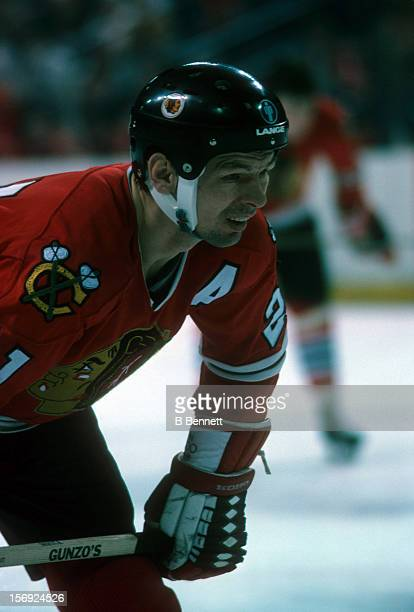 Stan Mikita of the Chicago Blackhawks waits for the faceoff during an NHL game against the Boston Bruins on January 11 1975 at the Boston Garden in...