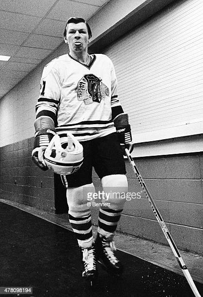 Stan Mikita of the Chicgao Blackhawks walks out to play against the New York Islanders while sticking his tongue out at the photographer on January 1...