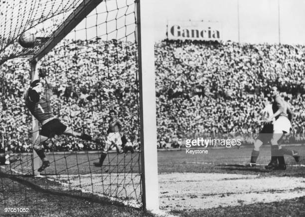 Stan Mortensen beats Italian goalkeeper Valerio Bacigalupo to score England's first goal in the 23rd minute of an international at the Stadio...
