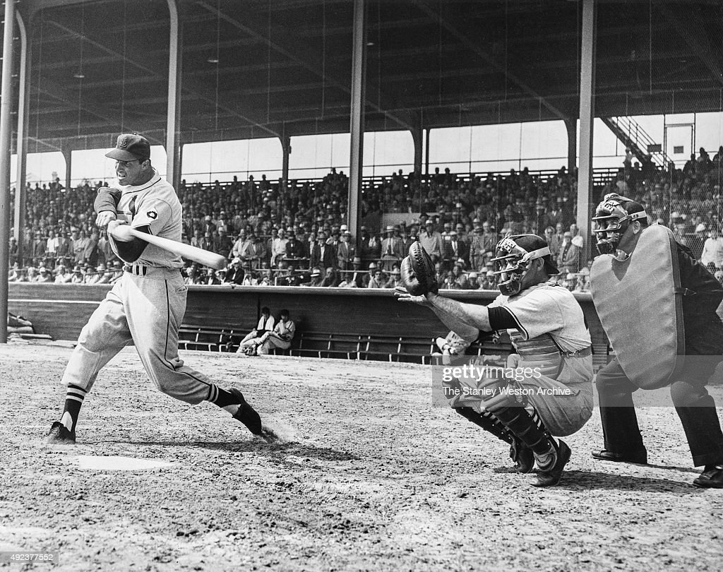 Stan Musial of the St. Louis Cardinals grimaces as hits the ball during the first squad game played by the St. Louis Cardinals on March 3, 1952 in St Petersburg, Florida.