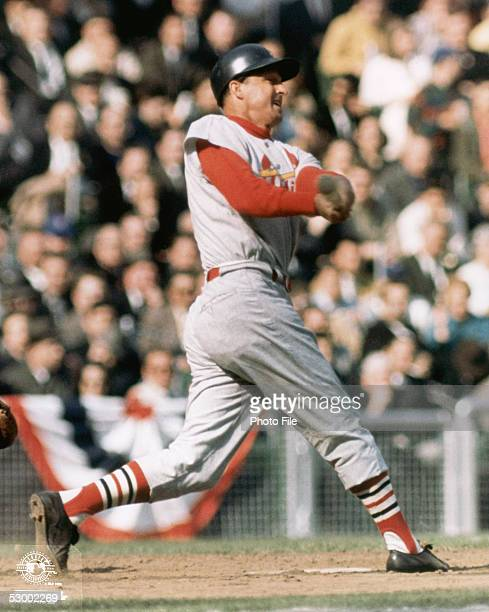 Stan Musial of the StLouis Cardinals swings at the pitch during a season game Stan Musial played for the StLouis Cardinals from 19411963