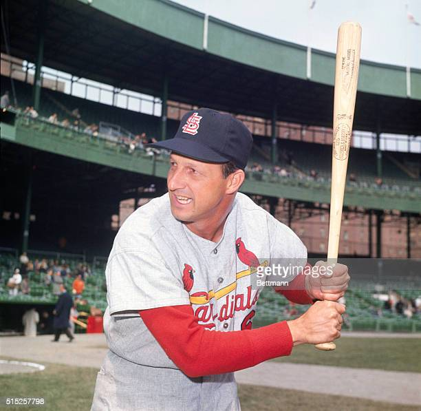 Stan Musial pitcher for the Saint Louis Cardinals poses with baseball bat at spring training