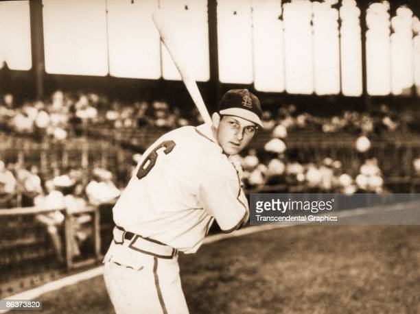 Stan Musial takes a batting pose for the camera before a game in Sportsmans Park in St Louis in 1948