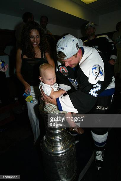 Stan Neckar of the Tampa Bay Lightning celebrates in the locker room with his son and the Stanley Cup after defeating the Calgary Flames in Game 7 of...