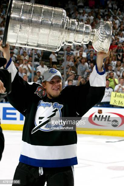 Stan Neckar of the Tampa Bay Lightning celebrates with the Stanley Cup trophy after defeating the Calgary Flames 21 to win game seven of the NHL...