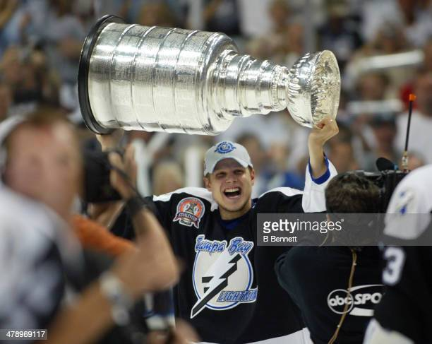 Stan Neckar of the Tampa Bay Lightning skates with the Stanley Cup after defeating the Calgary Flames in Game 7 of the NHL Stanley Cup Finals on June...