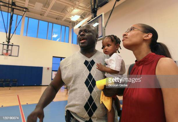 Stan Rogers, class of 1989 looks around the Burke's new gymnasium in amazement during a reunion visit and tour with son Xavier, 14 months, and wife...