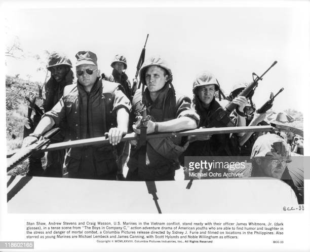 Stan Shaw Andrew Stevens Craig Wasson stand ready with their officer James Whitmore Jr in a scene from the film 'The Boys in Company C' 1978