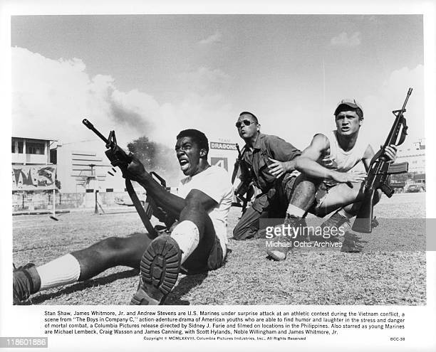Stan Shaw James Whitmore Jr and Andrew Stevens come under surprise attack in a scene from the film 'The Boys in Company C' 1978