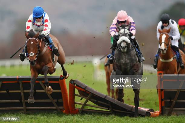 Stan Sheppard riding Tommy Silver clears the last on his way to victory from Harry Skelton on Bertimont in the Weatherbys Cheltenham Festival Betting...