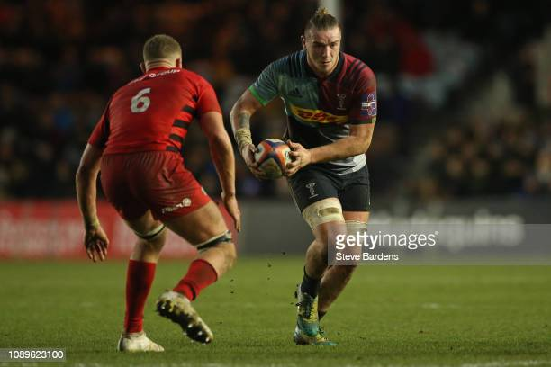 Stan South of Harlequins takes on Nick Isiekwe of Saracens during the Premiership Rugby Cup match between Harlequins and Saracens at Twickenham Stoop...