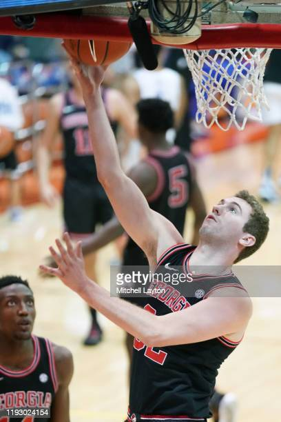 Stan Turnier of the Georgia Bulldogs drives to the basket during a third round Maui Invitation basketball game against the Chaminade Silverswords at...