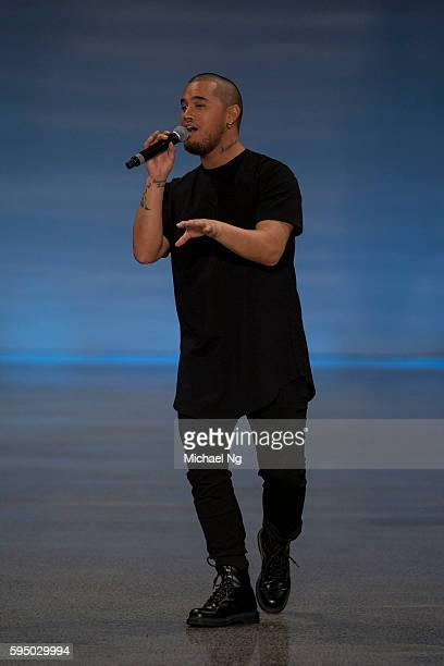 Stan Walker performs on the runway during the Rochelle show at New Zealand Fashion Week on August 25 2016 in Auckland New Zealand