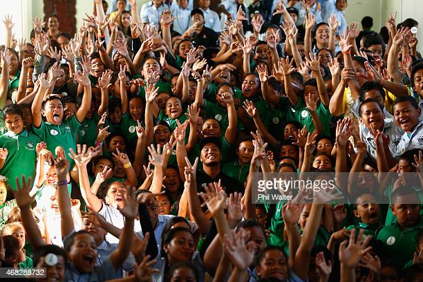 Stan Walker sits amongst school children after being announced as an ambassador for the FIFA U20 World Cup at Sutton Park School on April 2 2015 in...