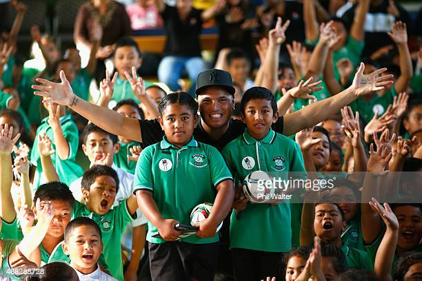 Stan Walker stands with school children Kazitoa Farani and Matilda Lako after being announced as an ambassador for the FIFA U20 World Cup at Sutton...