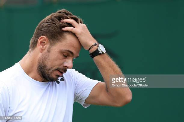 Stan Wawrinka looks dejected against Reilly Opelka during their Gentlemen's Singles 2nd Round match on Day 3 of The Championships - Wimbledon 2019 at...