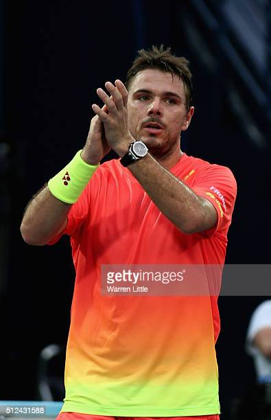 Stan Wawrinka of Switzerland acknowledges the crowd after winning his semi final match as Nick Kyrgios of Australia retires injured on day seven of...