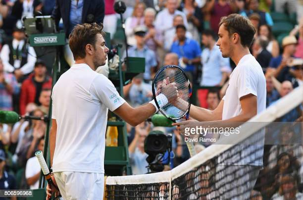Stan Wawrinka of Switzerland and Daniil Medvedev of Russia shake hands after their Gentlemen's Singles first round match on day one of the Wimbledon...