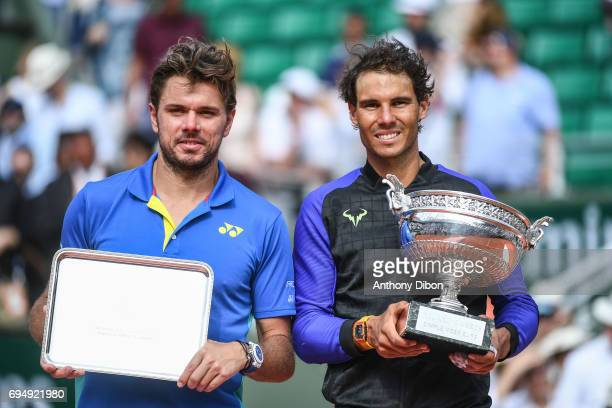 Stan Wawrinka of Switzerland and Rafael Nadal of Spain poses with their trophies during the day 15 of the French Open at Roland Garros on June 11...