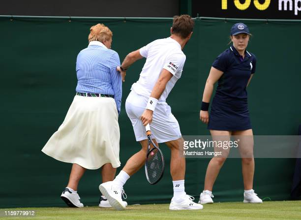 Stan Wawrinka of Switzerland apologises to the line judge in his Men's Singles second round match against Reilly Opelka of The United States during...