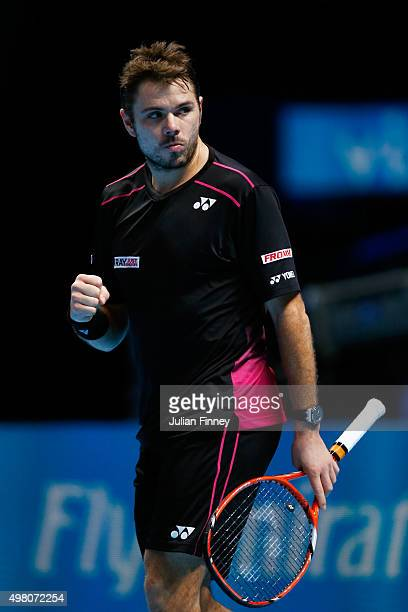 Stan Wawrinka of Switzerland celebrates a point during the men's singles match against Andy Murray of Great Britain on day six of the Barclays ATP...