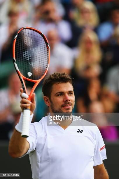 Stan Wawrinka of Switzerland celebrates after winning his Gentlemen's Singles third round match against Denis Istomin of Uzbekistan on day seven of...