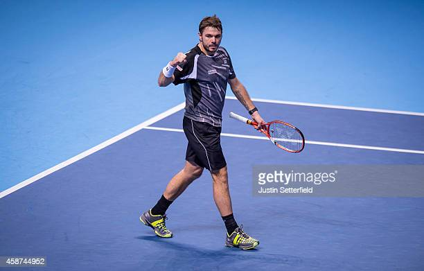 Stan Wawrinka of Switzerland celebrates after winning his match against Tomas Berdych of Czech Republic 20 in the round robin during day two of the...