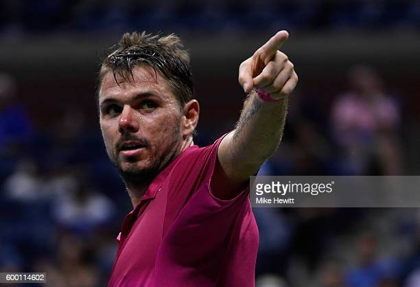 Stan Wawrinka of Switzerland celebrates defeating Juan Martin del Potro of Argentina during their Men's Singles Quarterfinals Match on Day Ten of the...