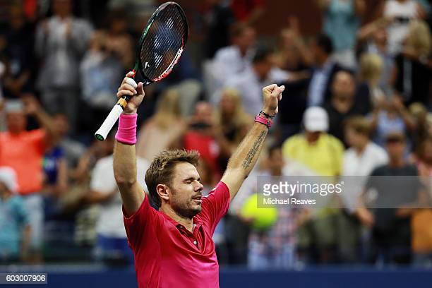 Stan Wawrinka of Switzerland celebrates defeating Novak Djokovic of Serbia with a score of 67 64 75 63 during their Men's Singles Final Match on Day...