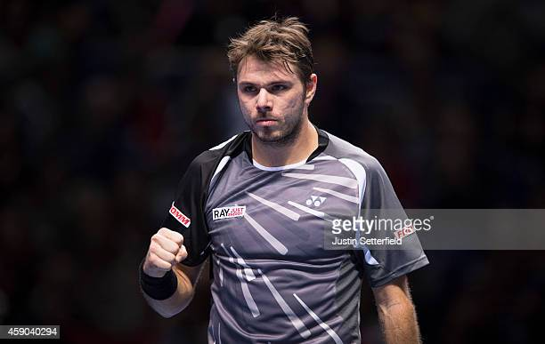 Stan Wawrinka of Switzerland celebrates during the singles semifinal match against Roger Federer of Switzerland on day seven of the Barclays ATP...
