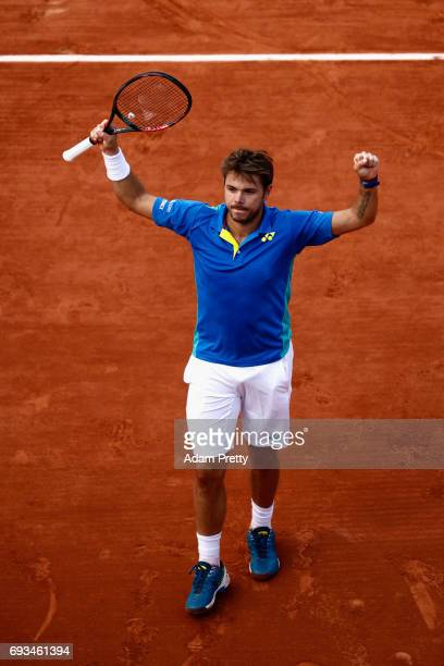 Stan Wawrinka of Switzerland celebrates his mens singles quarter final victory over Marin Cilic of Croatia on day eleven of the 2017 French Open at...
