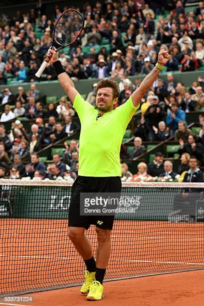 Stan Wawrinka of Switzerland celebrates his victory during the Men's Singles first round match against Lukas Rosol of Czech Republic on day two of...