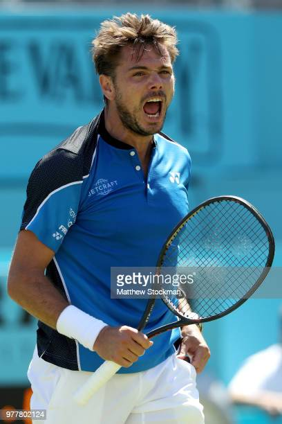 Stan Wawrinka of Switzerland celebrates match point during his men's singles match against Cameron Norrie of Great Britain during Day One of the...