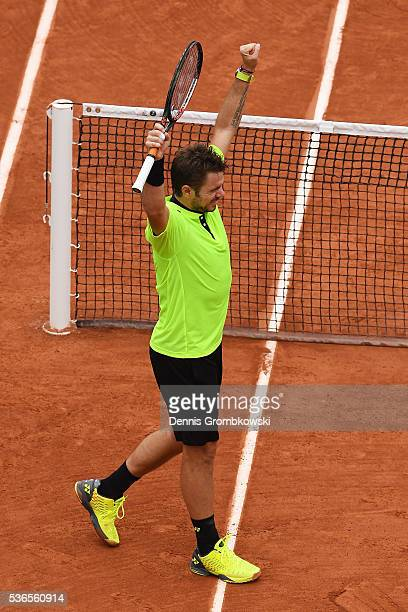 Stan Wawrinka of Switzerland celebrates victory during the Men's Singles quarter final match against Alberto Ramos Vinolas of Spain on day eleven of...