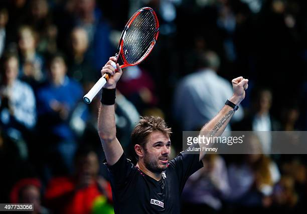 Stan Wawrinka of Switzerland celebrates victory in his men's singles match against David Ferrer of Spain during day four of the Barclays ATP World...