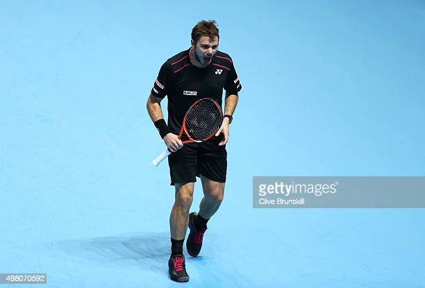 Stan Wawrinka of Switzerland celebrates winning the first set during the men's singles match against Andy Murray of Great Britain on day six of the...
