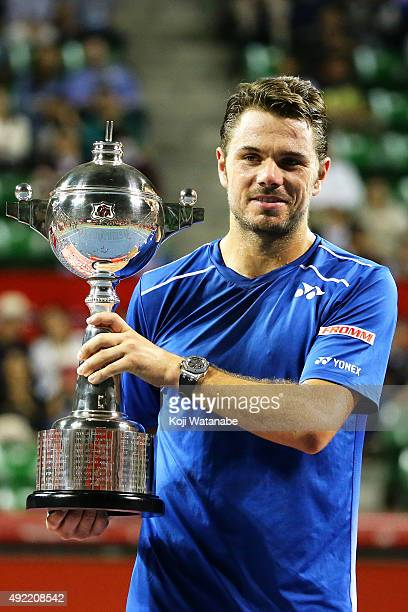 Stan Wawrinka of Switzerland celebrates with his trophy after winning the men's singles final match against Benoit Paire of France on Day Seven of...