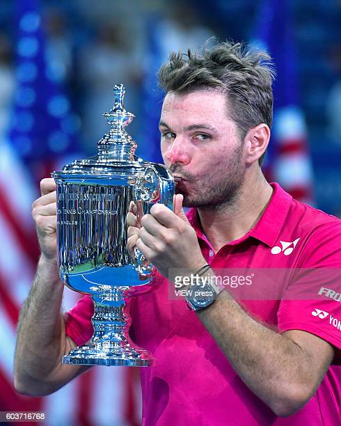 Stan Wawrinka of Switzerland celebrates with the trophy after his victory over Novak Djokovic of Serbia during their Men's Singles Final Match of the...