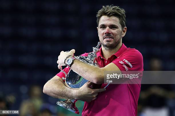 Stan Wawrinka of Switzerland celebrates with the trophy after defeating Novak Djokovic of Serbia with a score of 67 64 75 63 during their Men's...