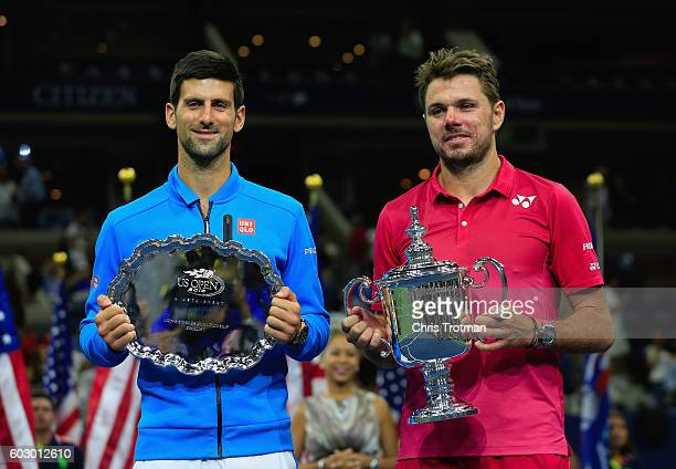 Stan Wawrinka of Switzerland celebrates with the winners trophy alongside second place Novak Djokovic of Serbia during their Men's Singles Final...