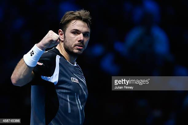 Stan Wawrinka of Switzerland celerates defeating Tomas Berdych of Czech Republic in the round robin during day two of the Barclays ATP World Tour...