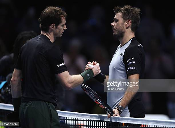 Stan Wawrinka of Switzerland congratulates Andy Murray of Great Britain after their men's singles match on day six of the ATP World Tour Finals at O2...