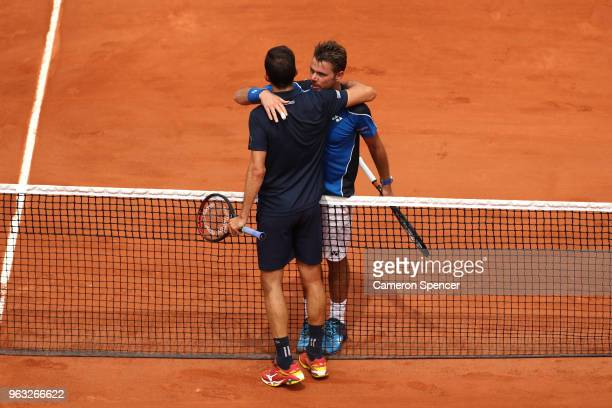 Stan Wawrinka of Switzerland congratulates Guillermo Garcia-Lopez of Spain on victory following during day two of the 2018 French Open at Roland...
